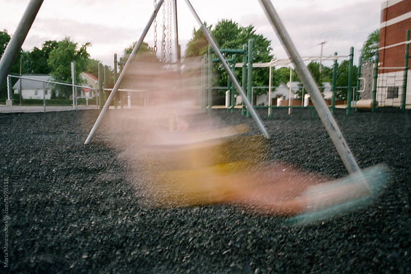 motion blur on swing by Maria Manco for Stocksy United