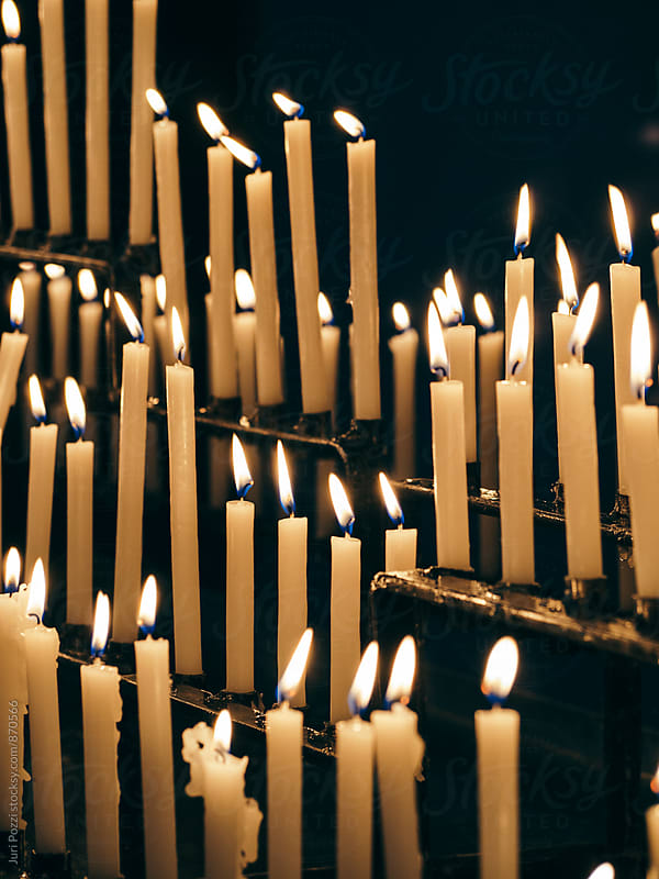 candles in a church by Juri Pozzi for Stocksy United