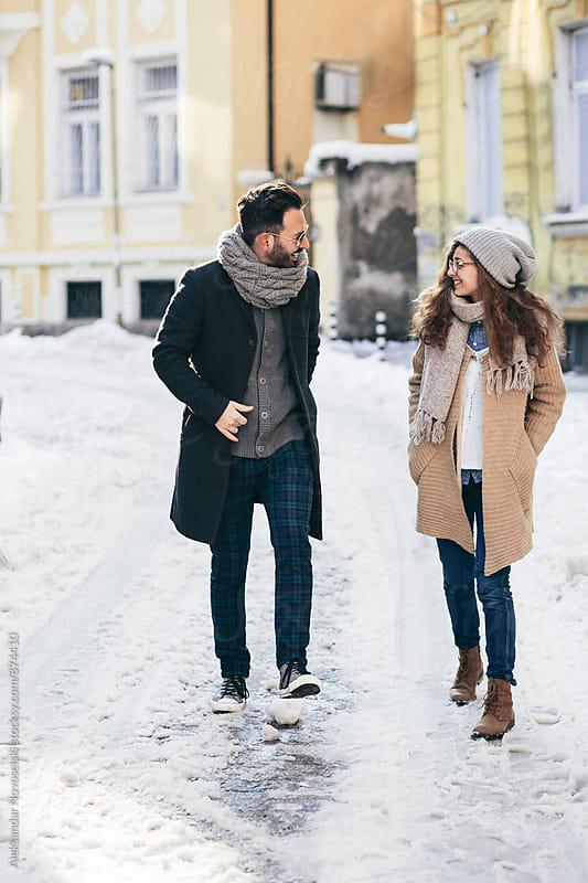 Two friends walking on the street by Aleksandar Novoselski for Stocksy United