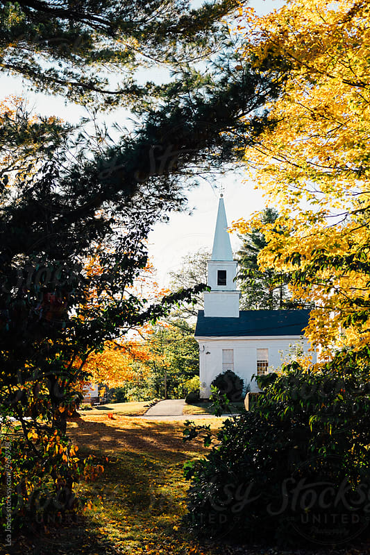 New-England church in the fall by Léa Jones for Stocksy United