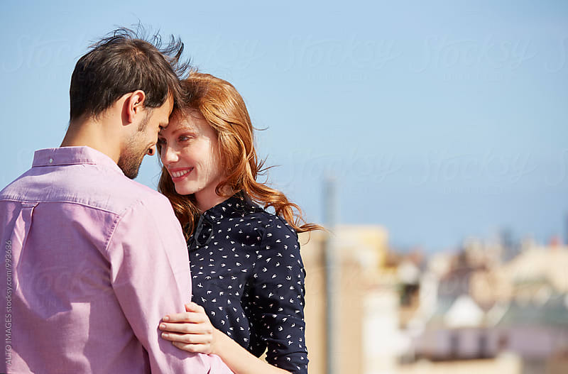 Loving Woman With Man Embracing In City by ALTO IMAGES for Stocksy United
