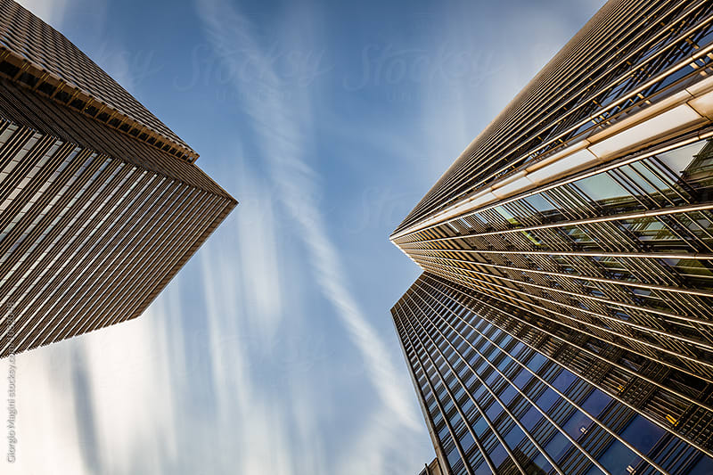 Corporate Skyscrapers from Below, Long Exposure at Daylight by Giorgio Magini for Stocksy United