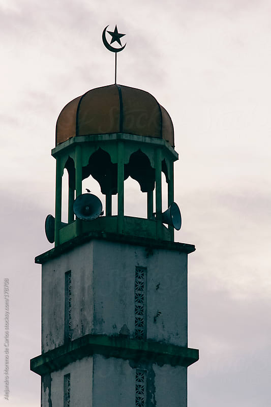Islamic mosque tower with islam symbol by Alejandro Moreno de Carlos for Stocksy United