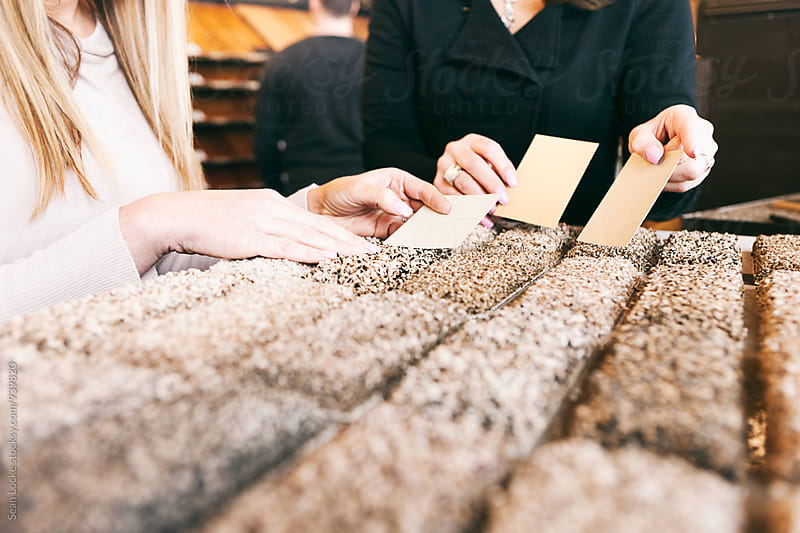 Design: Woman Trying To Choose Carpet To Match Paint by Sean Locke for Stocksy United