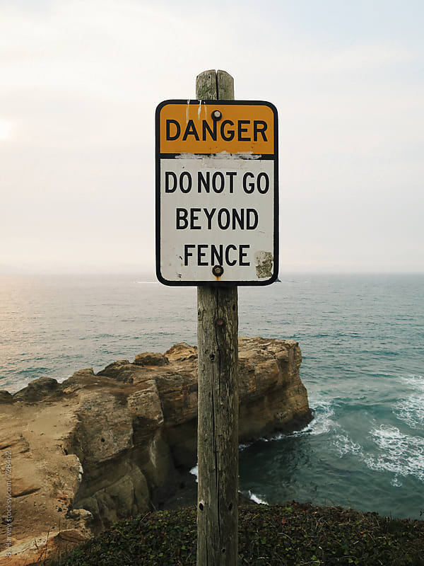 Danger - Do Not Go Beyond Fence by B. Harvey for Stocksy United