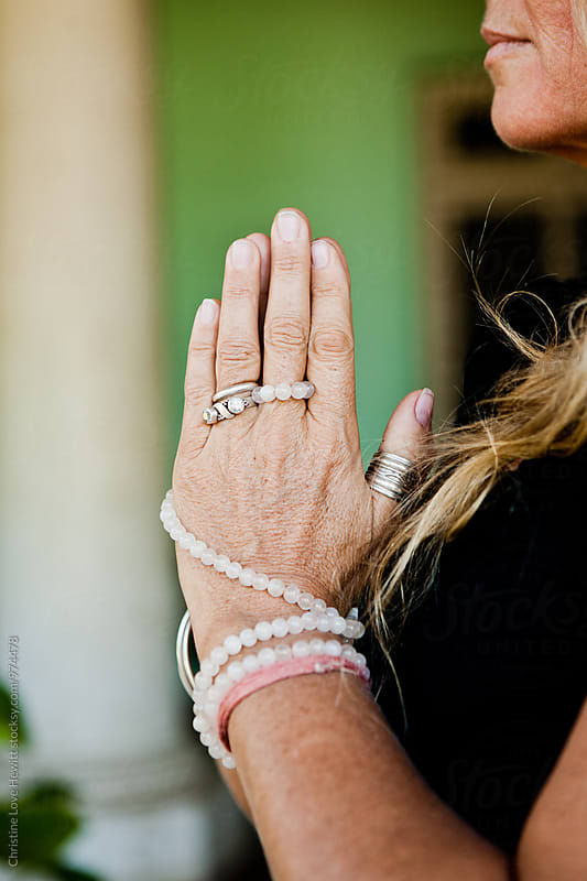 Hands in namaste by Christine Hewitt for Stocksy United