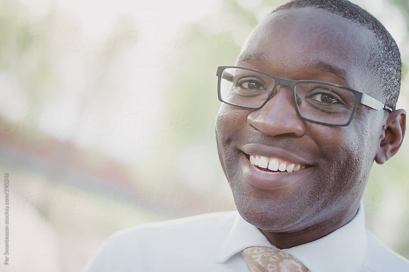 Handsome smiling young black man with tie by Per ...