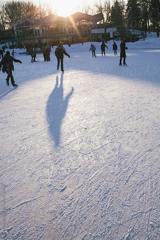 Shadows of skaters on the ice by Erik Naumann for Stocksy United