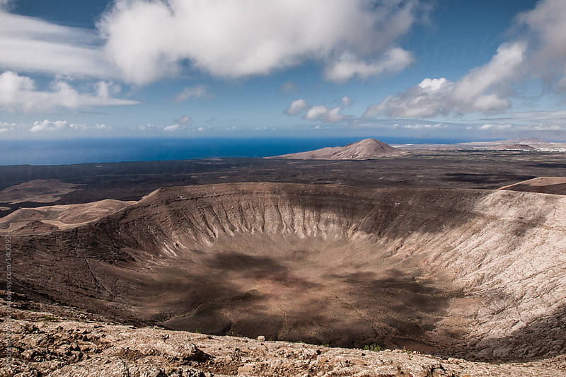 View from crater rim in Lanzarote by Andreas Wonisch for Stocksy United