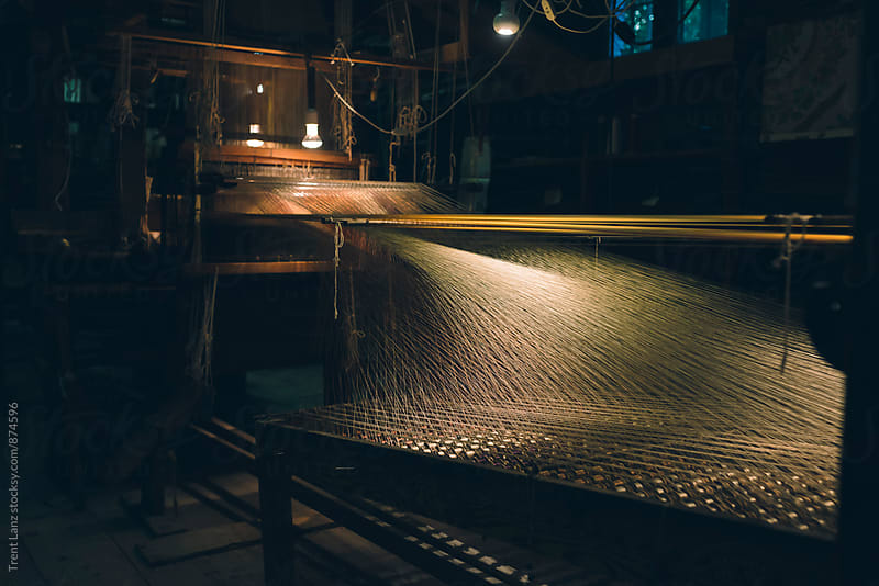 Vintage loom with threads stretching. Process of weaving by Trent Lanz for Stocksy United