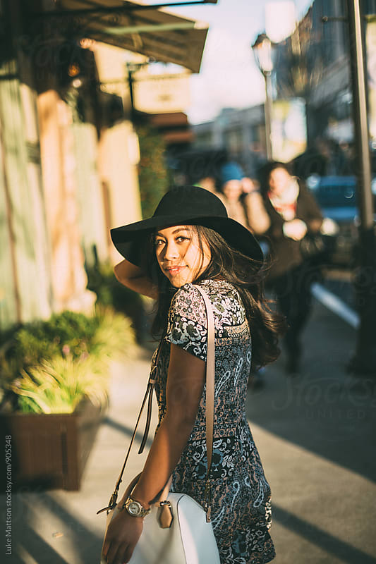 Attractive Young Woman Walking Outside Shopping Mall by Luke Mattson for Stocksy United