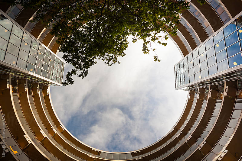 Modern round luxury apartment building by Mima Foto for Stocksy United