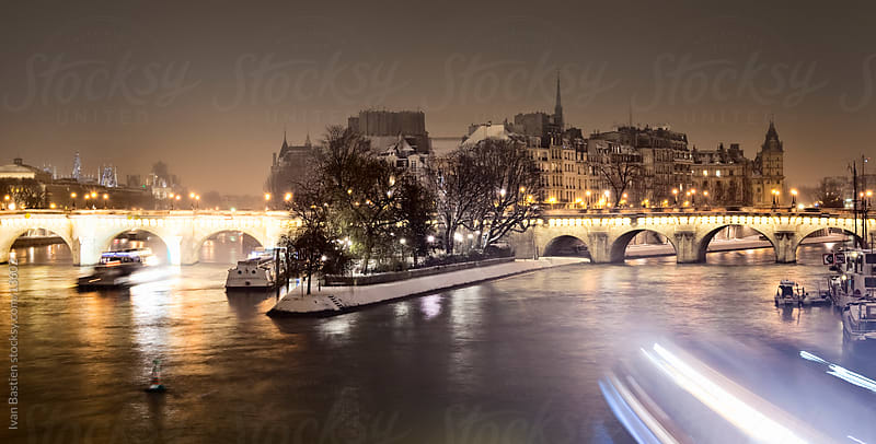 River Seine in Paris on a snowy winter night by Ivan Bastien for Stocksy United