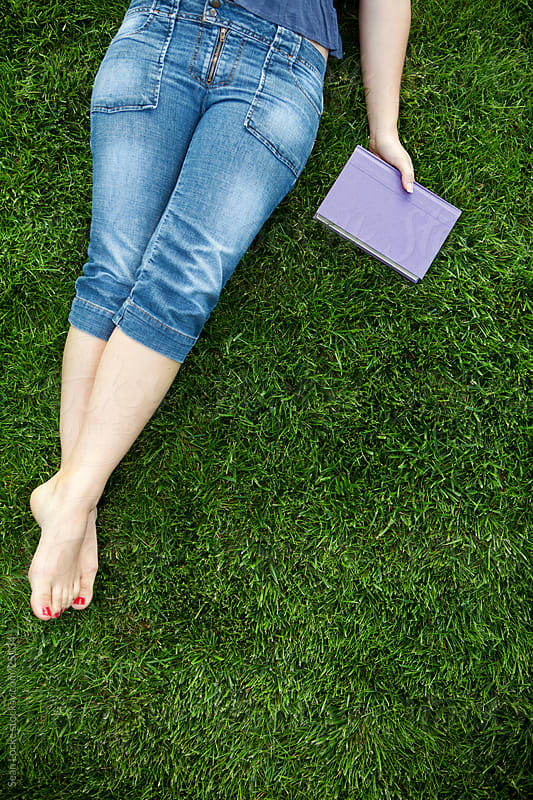 Grass: Reading Outside on a Grassy Space by Sean Locke for Stocksy United