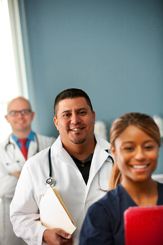 Exam Room: Focus on Hispanic Doctor by Sean Locke for Stocksy United