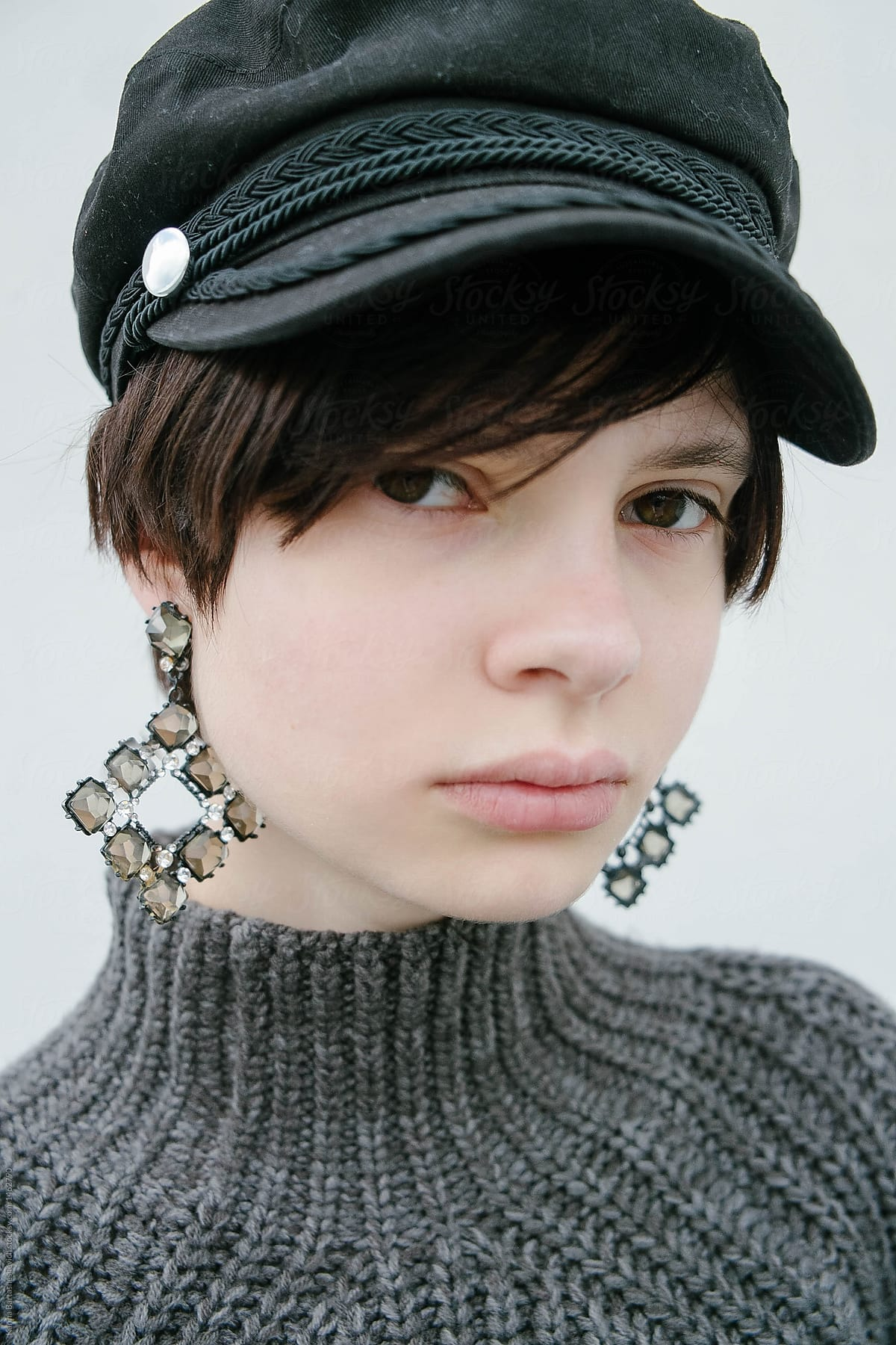 abaf4505be742 portrait of sophisticated young fashion girl with short hair with the hat  with earrings