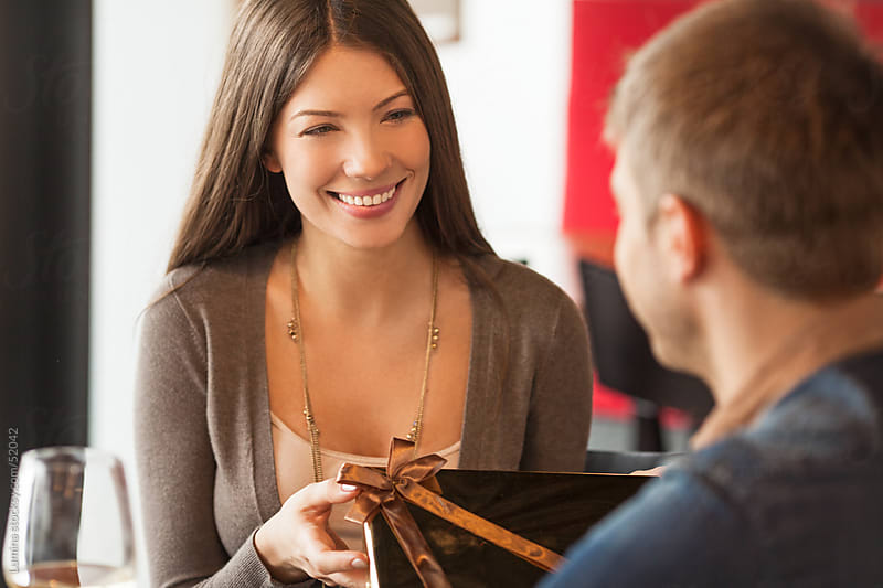 Woman Getting a Present from her Boyfriend by Lumina for Stocksy United