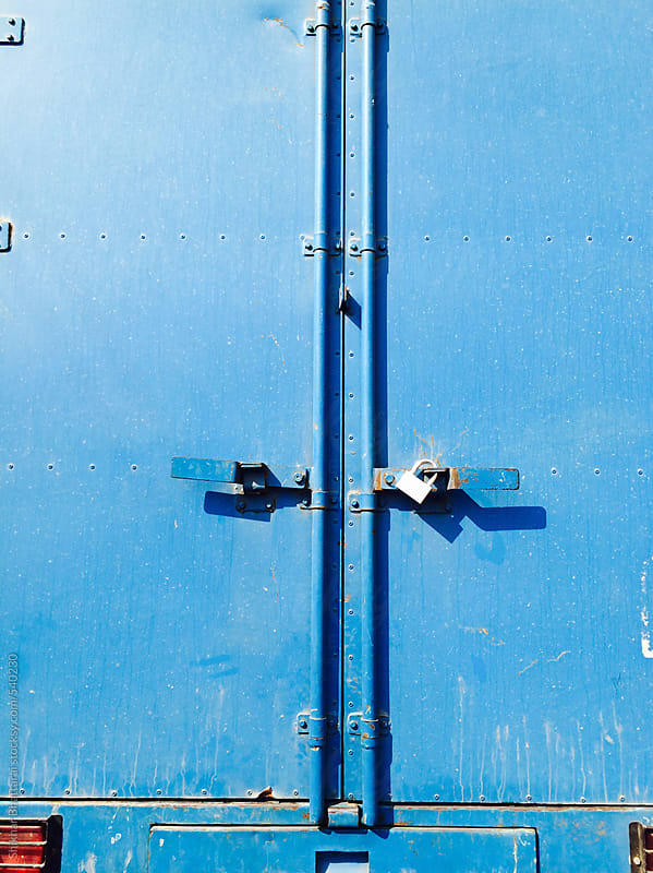 Back of a blue storage van. by Shikhar Bhattarai for Stocksy United