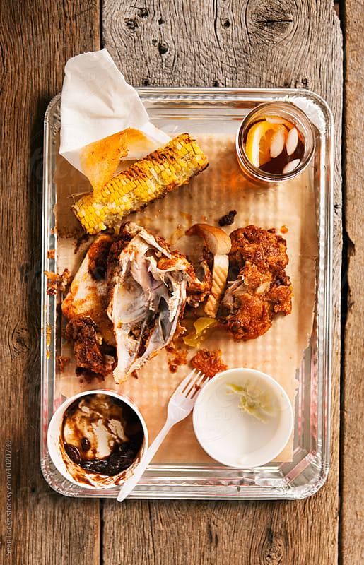 Fried: Remains Of Dinner Of Chicken And Sides by Sean Locke for Stocksy United