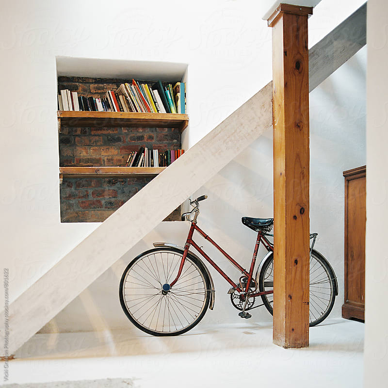 Modern Loft with Bike and bookeshelves  by Vicki Grafton Photography for Stocksy United
