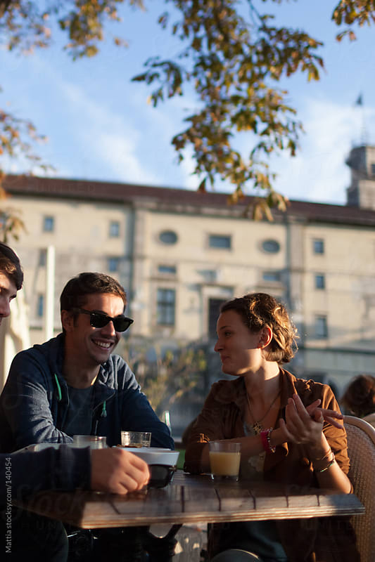 Friends are Talking during Aperitif by HEX. for Stocksy United