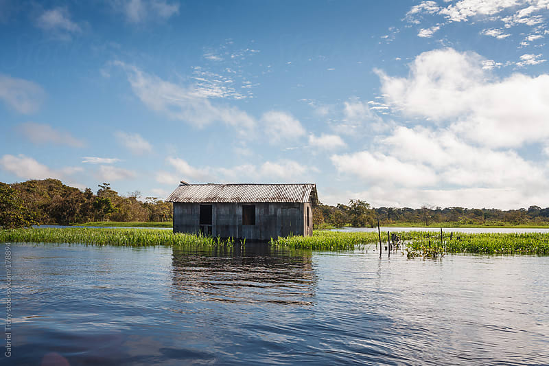 Old house on Amazon river by Gabriel Tichy for Stocksy United