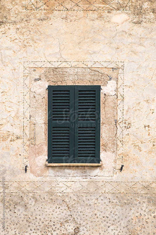 Window with green wooden shutter by Marilar Irastorza for Stocksy United