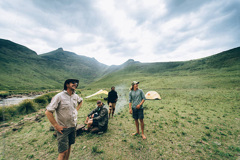 hikers enjoying the view from their camp in the mountains by Micky Wiswedel for Stocksy United