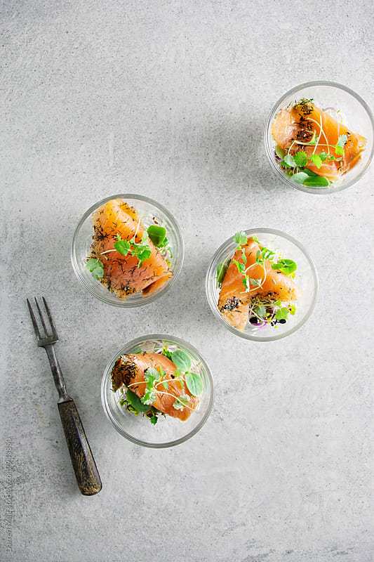 Smoked salmon salad appetizers served in glasses, seen from overhead. by Darren Muir for Stocksy United