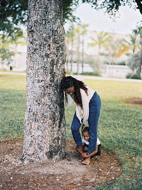 African American mother playing with her daughter at the park by Marlon Richardson for Stocksy United