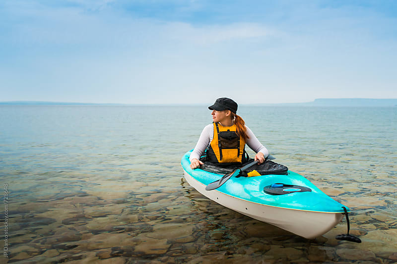 Woman Enjoying Quiet Morning in Sea Kayak Paddling on Freshwater Lake at Summer Family Cottage by JP Danko for Stocksy United