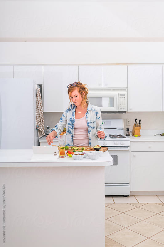 Woman Prepares a Mexican Meal in the Kitchen by suzanne clements for Stocksy United
