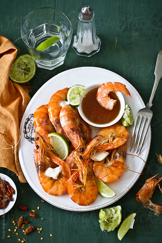 Prawns with lime, chili and butter by Török-Bognár Renáta for Stocksy United