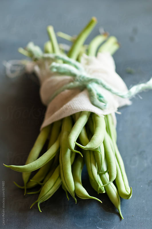 a bunch of french beans by Laura Adani for Stocksy United