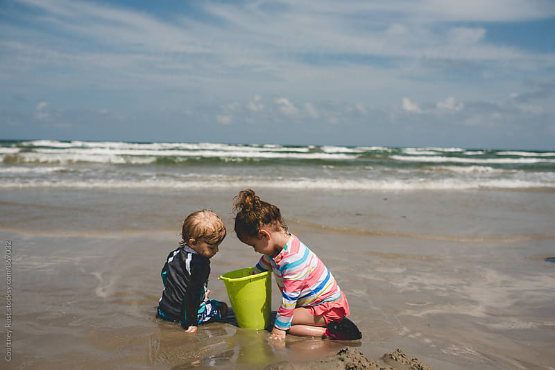 collecting at the beach by Courtney Rust for Stocksy United