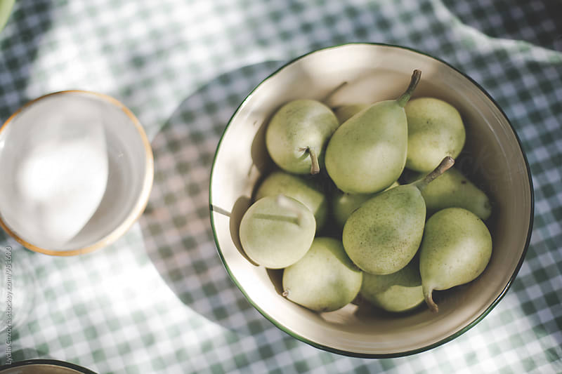 Freshly picked green pears on the table by Lydia Cazorla for Stocksy United