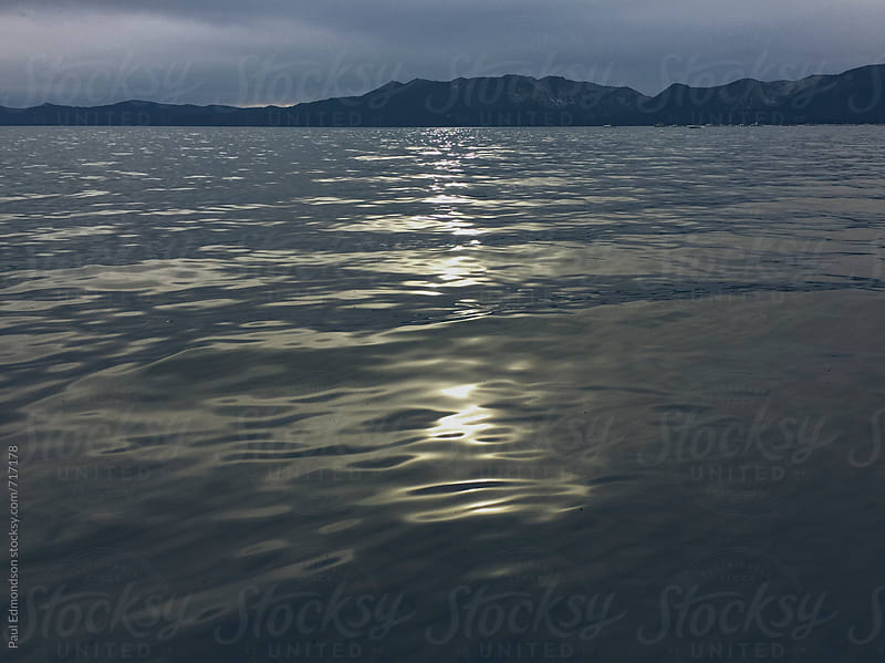Overcast sky on Lake Tahoe by Paul Edmondson for Stocksy United