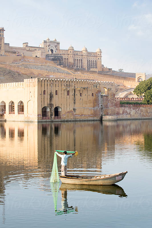 Fisherman on lake below Amber Fort. Jaipur. India. by Hugh Sitton for Stocksy United