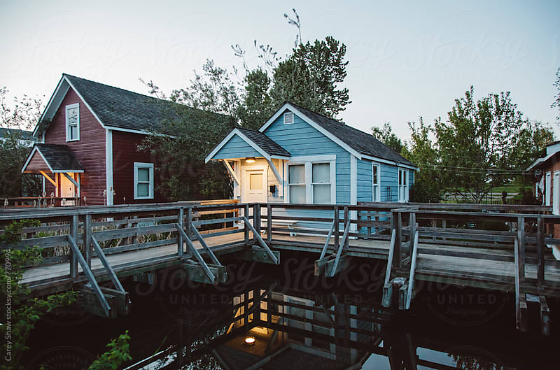 Small blue house at dusk by Carey Shaw for Stocksy United