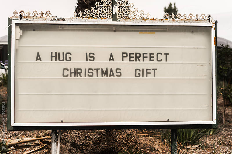 church sign reading: a hug is a perfect christmas gift by Gillian Vann for Stocksy United