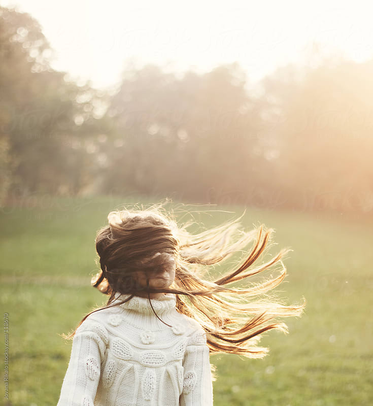 Little girl with her hair flying off to one side by Jovana Rikalo for Stocksy United