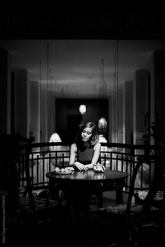 Beautiful Asian young woman drinking in Shanghai restaurant by Nabi Tang for Stocksy United