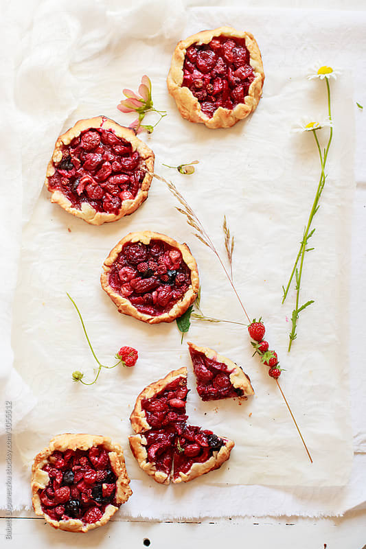 Mini wild strawberry galette by Viktorné Lupaneszku for Stocksy United