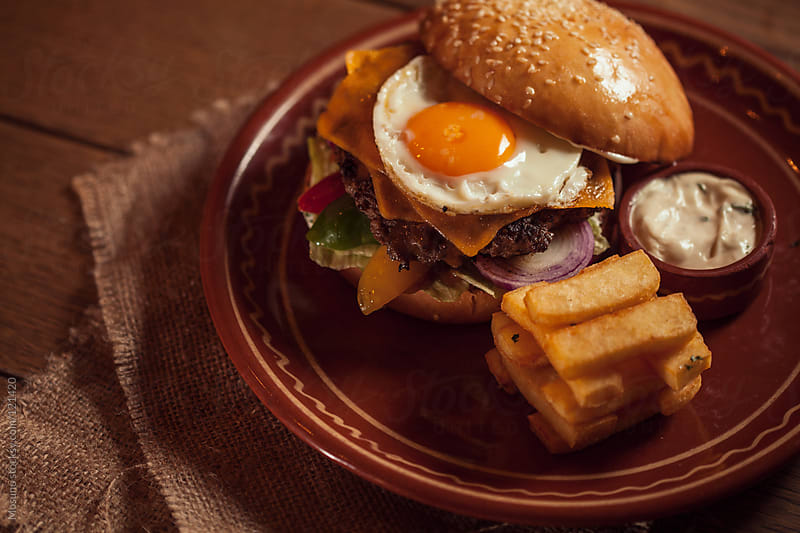 Texas Burger With French Fries by Mosuno for Stocksy United