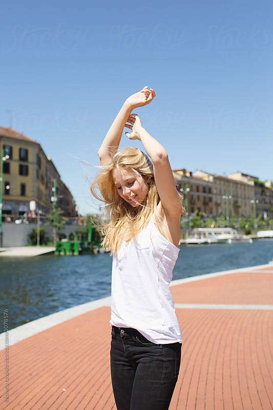 Blond girl enjoying the city in summer by michela ravasio for Stocksy United