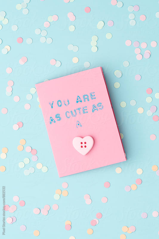 Cute as a button pastel-colored Valentine's Day card by Pixel Stories for Stocksy United
