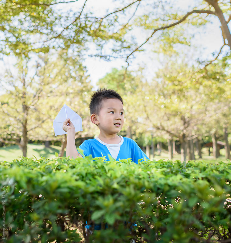 Asian boy playing with handmade airplane by Lawren Lu for Stocksy United