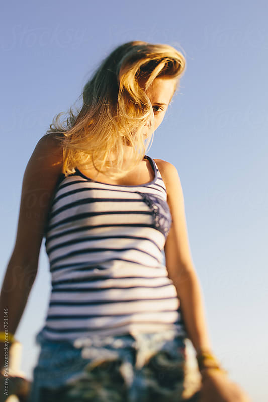 Woman looking at camera by Andrey Pavlov for Stocksy United