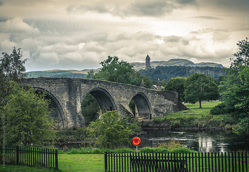 Stirling Bridge over the river Forth with the Wallace Monument i by Leander Nardin for Stocksy United