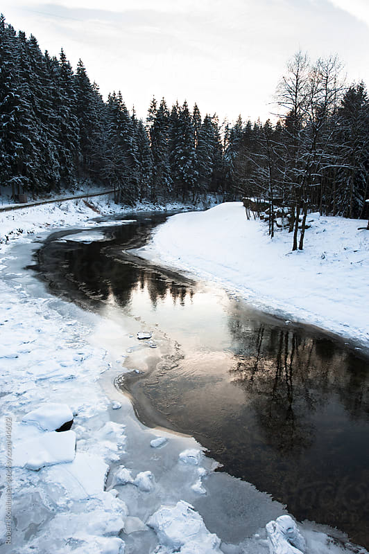 Frozen river in winter by Robert Kohlhuber for Stocksy United